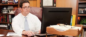 Attorney Courie with a Computer